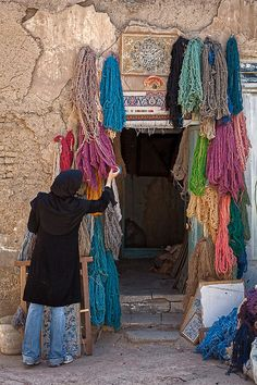 Shopping for brightly colored wool. Isfahan, Iran.