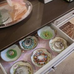 using old china cups to store jewelry, so pretty