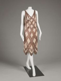 Evening dress. Designer: Madeleine Vionnet; Ernesto Thayaht Date: ca. 1922–1928 Place of origin: France  Medium: Silk crepe with opalescent glass bead embroidery.  Source: art.famsf.org