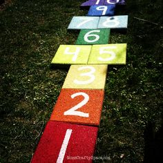 Use pavers to create an outdoor rainbow hopscotch for your backyard.