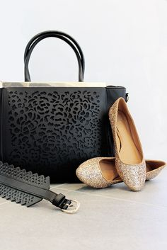 Accessories make the outfit! Add some sparkle to your step in these gold flats. Grab an over-sized black bag to store all your holiday goodies.