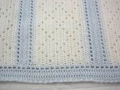 """This lovely afghan is ready to ship! This pretty diamond filet pattern was crocheted with a soft, lightweight acrylic baby sport yarn and is approximately 34"""" x 36"""", perfect for your newborn baby! Its shown here in a lovely lightly Sparkly White with Blue"""