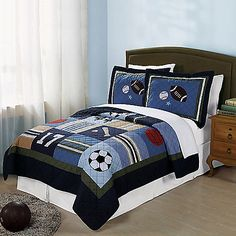 Perfect for your little sports fan, the All State Quilt Set is decorated with footballs, soccer balls, and baseballs that are hand-pieced and embroidered for a unique and richly textured look.
