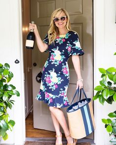 Summer is so much easier if you have the perfect carry-all tote and an easy-to-wear summer dress. See what's inside Reese's summer bag here.