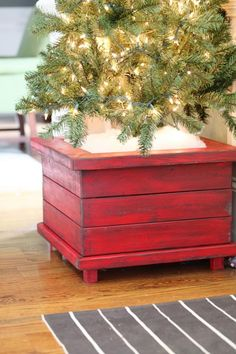 Woodworking Vise Workbenches DIY Christmas Tree Planters step-by-step instructions on getting this rustic sanded glaze-y look.Woodworking Vise Workbenches DIY Christmas Tree Planters step-by-step instructions on getting this rustic sanded glaze-y look Christmas Tree Stand Diy, Creative Christmas Trees, Christmas Is Over, Wood Christmas Tree, Country Christmas, Christmas Projects, White Christmas, Christmas Holidays, Christmas Decorations