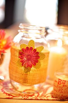 DIY Wedding decor. Burlap + scrapbook flowers + mason jars + candles = super cute table decor.