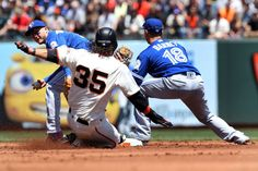 Safe slide:    San Francisco Giants shortstop Brandon Crawford (35) is safe at second base in front of Toronto Blue Jays shortstop Troy Tulowitzki (2) and second baseman Darwin Barney (18) during the game on May 11 in San Francisco. The Gaints won 5-4.