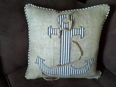 18x18 burlap and ticking pillow with anchor. zipper and welt. $35.00, via Etsy.