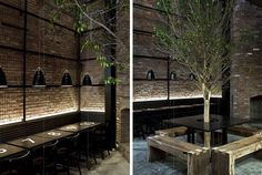 Dramatic restaurant design that I would use for outdoor dining room. Love the idea of a full size brick fireplace