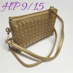 """Charming Charlie bag This is a NWOT Charming Charlie small gold woven crossbody bag. It has two zippered compartments, and one smaller zippered compartment between the two. There are credit card slots on either side of the smaller zippered pocket. Approximate dimensions include: width 6.5"""", height 5"""" and depth 2"""". The strap, not including the clasps, is approximately 49"""". The wristlet strap is not included with this bag. Charming Charlie Bags Crossbody Bags"""