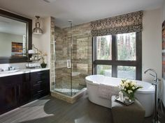 The luxurious master bathroom features nature-inspired materials, floor-to-ceiling views and industrial accents.    http://www.hgtv.com/dream-home/master-bathroom-pictures-from-hgtv-dream-home-2014/pictures/index.html?soc=pindhm
