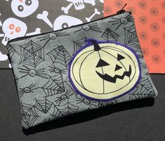 Spiders and Spiderwebs Zipper Pouch: Halloween, Jack-o-Lantern Appliqué.