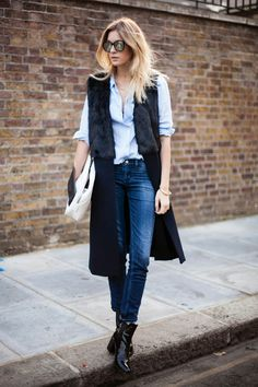 Blue Skinny Jeans Outfit Inspiration. #bluejeans #skinnyjeans #denim #repeatoffender #howtostyle #howtowear #ootd #outfitinspiration #camilleovertherainbow #fauxfurvest #lightblueshirt