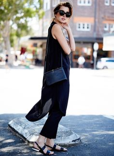 Dress over pants with leather sandals and a Celine bag.
