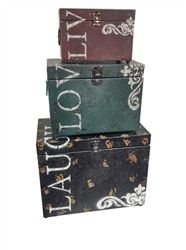 """Classic Live, Love & Laugh Iron Storage Trunk Set of 3. The most thoughtful gift is that of love and laughter. This set of storage trunks combine that message with a charming style of decoration. Each of the three feature stylish reminders to """"live, love and laugh."""" Made with aged iron alloy throughout, each trunk is suited to be as useful as it is thoughtful."""