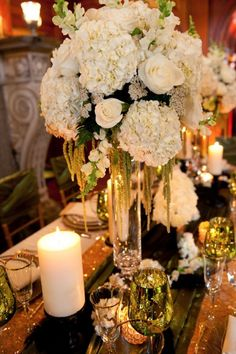 Best Wedding Centerpieces of 2014 - - love this- hydrangeas- the hanging vine like things, candles, mirrors