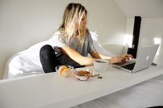 Work from bed with IKEA's MALM occasional table.