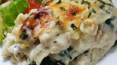 Thick with an abundance of mozzarella, Parmesan and ricotta cheeses, this chicken and spinach lasagna could make you forget all about the tomato kind! Ricotta Chicken, Chicken Artichoke Bake, Chicken Spinach Lasagna, Spinach Ricotta, Cheesy Chicken, Spinach Meals, Cooked Spinach Recipes, Spinach Lasagna Rolls, Spinach Bake