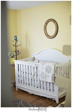 white crib, vintage frame, gray, yellow and white nursery