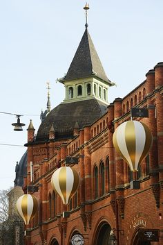 Air balloons on Östermalms Saluhall in Stockholm by Michel Bussien and First sight