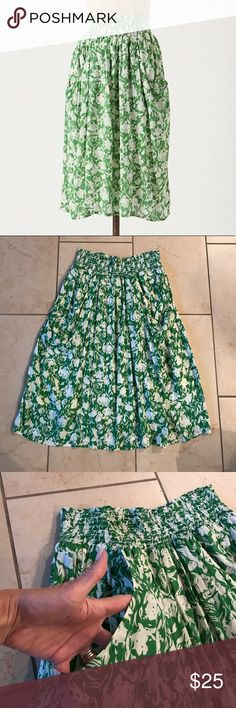 Anthropologie Porridge skirt size L Excellent condition Anthropologie Porridge skirt size L. Bright green pattern, adorable deep front pockets and elastic smocked waist make this just the cutest. Lined. Length of skirt is 28 inches. I am also selling the same style and size skirt in a beautiful bright blue pattern as well. Anthropologie Skirts Midi