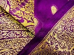 A purple and yellow indian traditional outfit known as a saree/sari Stock Photo