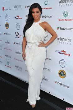 Kim Kardashian Evening Dress - The now engaged Kim Kardashian was simply breathtaking in a white draped evening gown for the Amberlounge Fashion Event in Monaco. Kim Kardashian White Dress, Kardashian Dresses, Estilo Kardashian, Kardashian Style, Kardashian Fashion, Kardashian Photos, Kardashian Kollection, Kardashian Jenner, Celebrity Inspired Dresses