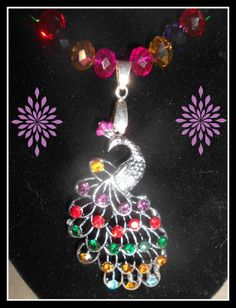 Peacock and swarovski necklace by Purrwoof on Etsy, $12.00
