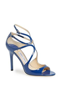 Jimmy Choo 'Lang' Sandal. Liquid-shine curves kiss at the vamp of a strappy sandal cast in an essential neutral hue.