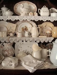 I love the china, the lace, and the linens. It looks like it has been collected over time and that is the look I like in my home.