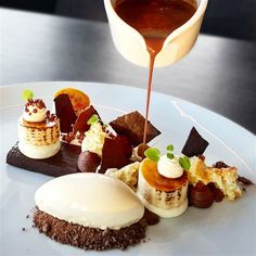 A parade of Bana Split with chocolate delice, vanilla ice cream, white chocolate mousse and milk chocolate sauce.