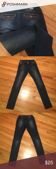 🐰Easter Bunny Sale!!🐰Stretch Denim Skinny Jeans Bling Pockets and button fly. These are a size 11 but fit more like a 7/9. Stretch medium to dark blue. Jeans Skinny