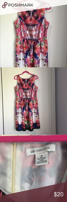 Liz Claiborne floral dress Gorgeous dress. This dress is in great condition. Only worn twice. It's a Liz Claiborne size 12. It has a beautiful floral print and a back zipper. This dress also has pockets! Who doesn't love a dress with pockets?! Liz Claiborne Dresses
