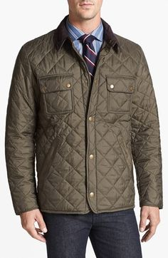 Quilted jacket with corduroy collar.