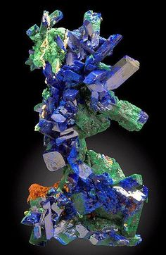 Intricately arranged specimen of Azurite crystals and Malachite ps after Azurite crystals - Morocco. photo: Exceptional Minerals  Geology Wonders