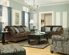 Brown leather couches in living room | living room furniture on Chocolate Living Room Set By Ashley Furniture ...love the colour