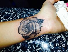 REALISTIC ROSE TATTOO on wrist/inner arm