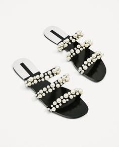 PEARLY STRAPPY SANDALS. 2600/201 Flat black sandals with three straps. Pearly detail on the straps. Laminated silver piece on the sole. ALL MY PRODUCTS ARE GENUINE ZARA, MANGO., ETC! These also will be deducted from the item's price.   eBay!