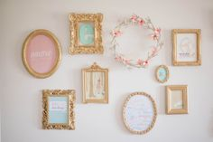pastel and gold gallery wall