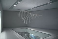 """BMW Kinetic Sculpture by Joachim Sauter    """"714 metal spheres are suspended from the ceiling on thin steel wires and animated with a help of mechanics, electronics and code"""""""