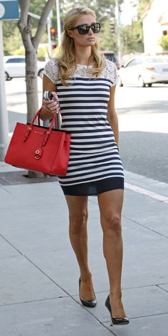 Not a big fan of Paris Hilton, but love this outfit. Nautical dress with lace shoulder detail and red bag. LA, 18 July 2014