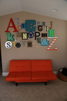 Alphabet wall for playroom - I'd turn my basement into a learning center...I'm such a teacher :-)