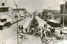 Workers rebuild an eastbound trolley track on West Colorado Avenue around 1910, before street paving began.