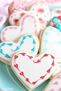 Looking for a great Valentine's Day sugar cookie recipe? These classic sugar cookies are decorated with royal icing in a variety of gorgeous Valentine's Day designs. They make wonderful edible gifts! Valentine's Day Sugar Cookies, Sugar Cookie Royal Icing, Fancy Cookies, Iced Cookies, Cookies Et Biscuits, Heart Cookies, Decorated Sugar Cookies, Royal Icing Decorated Cookies, Flower Sugar Cookies