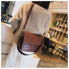 The Ava Cross Body Bag is defined by its casual elegance and practicality. The high-quality faux leather and perfect finish give it a simple beauty that you can enjoy every day. Details: Material: PU Size: X 10 cm X Gold details Purses And Handbags, Leather Handbags, Leather Bags, Brown Crossbody Bag, Brown Bags, Everyday Bag, Cloth Bags, Womens Tote Bags, Cross Body Handbags