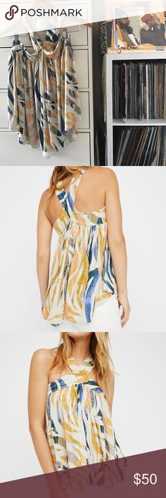 """FP Milly Off Shoulder Shirt 🙏 Free People  Milly Printed Tank Size medium  Crisscross straps or Wear off shoulder  Floral tribal print Cream with blue and yellow Swingy oversized fit  Soft and stretchy  Uneven hem  Measurements laying flat  Bust 21"""" Length 22"""" from upper bust to bottom hem (as if it was measured like a tube top)  Brand new with tags Free People Tops Tank Tops"""