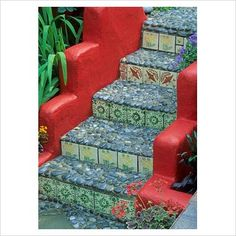 Garden steps with tiled risers and pebble treads