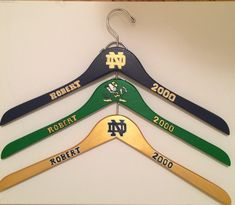 University of Notre Dame Fighting Irish Personalized Wooden Clothing Hanger / Leprechaun / Sports Fan Gift / College Gift / Alumni Gift http://etsy.me/2mVpboU #furniture #storage #green #graduation #gold #wood #woodenhanger #highschoolgift