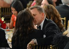 His leading lady: Daniel Craig leaned in and gave his wife Rachel Wesiz a kiss on the lips as they attended the 2012 BAFTA Los Angeles Britannia Awards