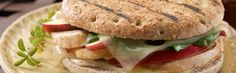 Chicken and Apple Panini  INGREDIENTS:  1 Oroweat® 100% Whole Wheat Sandwich Thins® roll  4 oz. chicken breast, skinless and boneless  2 slices reduced-fat Swiss cheese  4 slices apple (any variety), thinly sliced  1 tsp. reduced-fat mayonnaise  1/2 c. baby spinach leaves